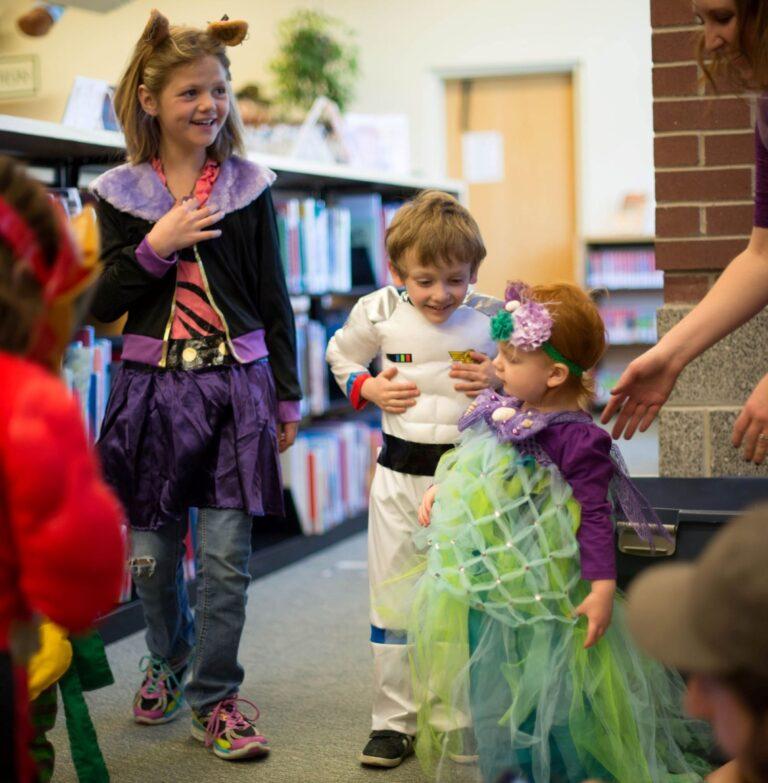 3 children in halloween costumes