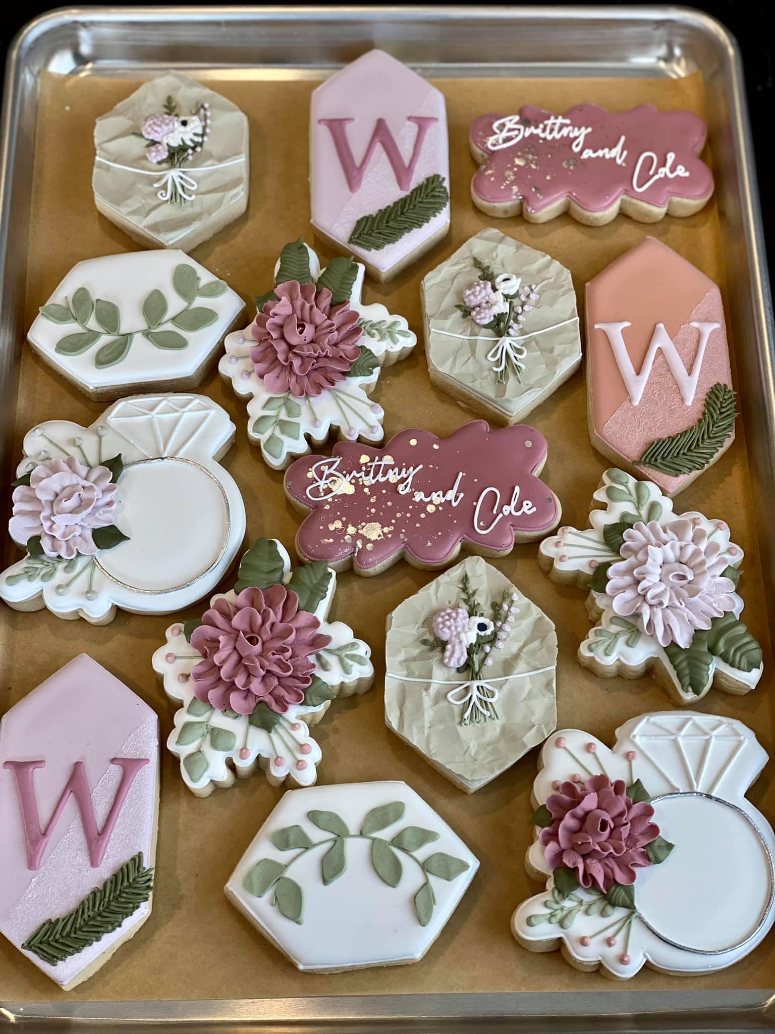 wedding cookies with floral arrangements